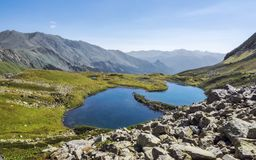 Mountain lake in Alps. Mountain lake in the Caucasian Alps in late summer Stock Photography