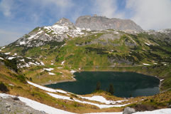 Mountain lake in the Alps Royalty Free Stock Photos