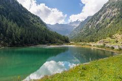 Mountain lake on the alps in summer, Macugnaga and lake delle Fate, Italy. Beautiful alpine lake located in Val Quarazza, lateral of the Anzasca valley, near the royalty free stock image