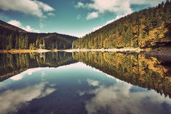 Mountain lake. Amazing panorama at sunset. Instagram filter Stock Images