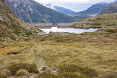 Mountain lake, Andora. Dam on the mountain lake in Pyrenees - Andora Stock Photos