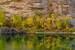 Mountain lake in autumn forest Stock Photos