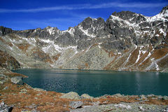 Mountain lake in autumn ( Hincovo pleso ) Royalty Free Stock Photos