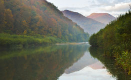 Mountain lake. Autumn landscape in the mountains with reflection in the lake Stock Image