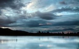 Mountain lake on the background of a dramatic sky Royalty Free Stock Photography