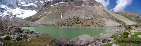 Mountain lake in background with high mountain. Tajikistan Royalty Free Stock Photos