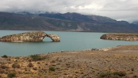 Mountain lake on background of low clouds in Patagonia Argentina. Unique landscape of wildlife. Beautiful nature. Travel and tourism in picturesque world of stock video footage