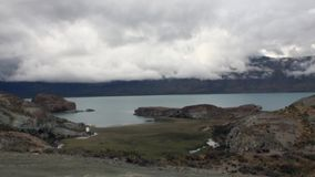 Mountain lake on background of low clouds in Patagonia Argentina. Unique landscape of wildlife. Beautiful nature. Travel and tourism in picturesque world of stock footage