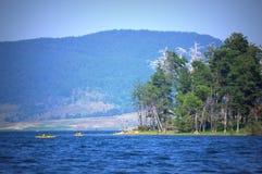 Mountain lake boating Stock Images
