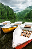 Mountain lake boats on a cloudy day Stock Photography
