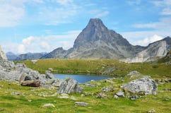 Mountain lake Casterau against the peak du Midi d'Ossau Stock Photos