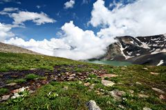 Mountain lake,Caucasus.Blue sky with white clouds. Stock Photography