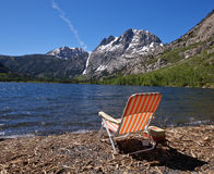 Chair on Mountain Lake Beach , California Stock Photo