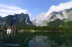 Mountain lake and church Stock Photos
