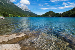 Mountain lake with clear water Austria, Tirol, Hintersteiner Lake, Wilder Kaiser Nature Reserve Stock Photo