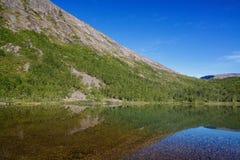 Mountain lake with clear water. Kola Peninsula , Khibiny . Russia Royalty Free Stock Images