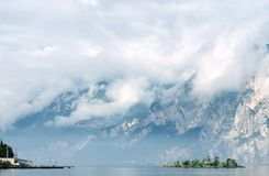 Mountain, lake, clouds, island. Stock Photo