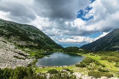 Mountain Lake and Cloudy Sky Stock Image