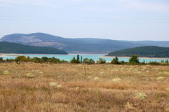 Mountain lake. The lake in Crimean mountains at hot summer midday Stock Photo