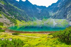 A mountain lake Czarny Staw with clear water in the Tatra mountains, a landmark of Poland royalty free stock image