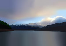 Mountain lake at dawn. A beautiful sunrise over a calm, tranquil, misty mountain lake Royalty Free Stock Photography