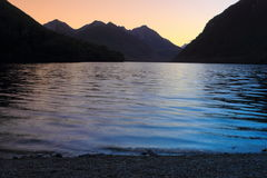 Mountain lake at dusk Stock Image