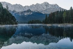 Mountain lake Eibsee in Bavarian Alps in the morning with reflection, Germany stock photography