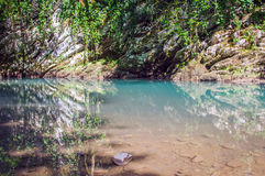 Mountain lake. Emerald color of water. Sunny day. In forest royalty free stock image