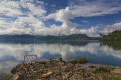 Mountain lake and fishing rods Royalty Free Stock Photo
