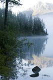 Mountain lake and fog Royalty Free Stock Photography