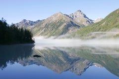 Mountain lake and fog Stock Image