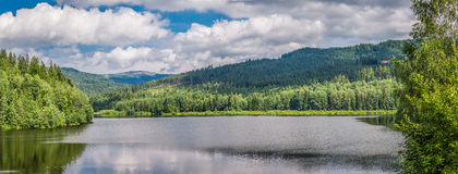 Mountain lake between forests Royalty Free Stock Photography