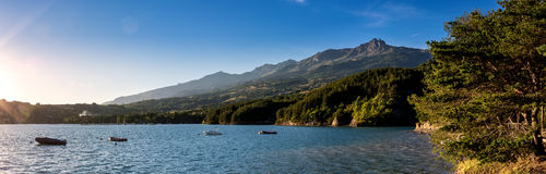 Mountain and lake in French Alpes. View from the Lac de Serre Poncon to the surrounding mountains stock photo