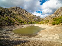 Mountain lake getting dried at the end of summer. royalty free stock image