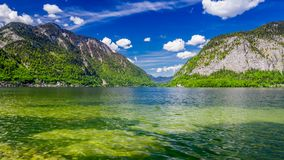 Mountain Lake in Hallstatt and clouds on a sunny day stock footage