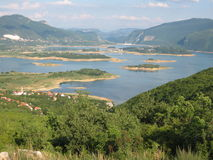 Mountain lake in Herzegovina. The Rama lake in Herzegovina. Beautiful nature and clean water. Paradise for those who seek untouched nature to relax Stock Image