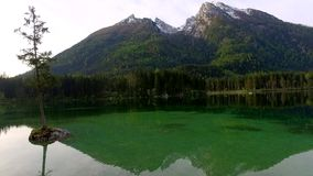 Mountain lake Hintersee at dawn in the Alps in Germany stock video footage