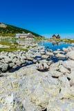 Mountain lake and hotel Royalty Free Stock Photos