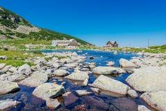 Mountain lake and hotel Royalty Free Stock Photo