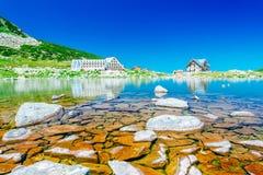 Mountain lake and hotel Stock Photo
