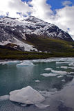 Mountain lake with ice floating in it Stock Photo