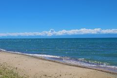 Mountain lake Issyk-Kul Royalty Free Stock Photos