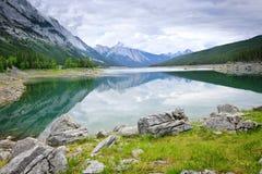 Mountain lake in Jasper National Park. Mountains reflecting in Medicine Lake in Jasper National Park, Canada Stock Photos