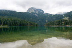 Mountain lake landscape. Mountain lake with mountains in the background and reflection on the water stock image