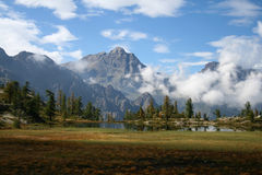 mountain lake in the italian Alps, panoramic view Royalty Free Stock Images