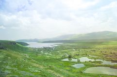 Mountain Lake. Landscape of the mountain sky and green valley. Armenia.  Stock Photo