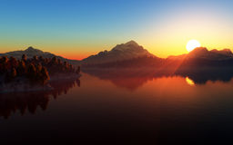 Mountain lake landscape. Mountain landscape at sunset with forest and lake in front and mountains with snow in the background Stock Photo