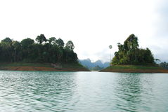 Mountain in lake. This mountain is in a large green lake.this place is in south of thailand Stock Photos