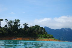 Mountain in lake. This is mountain in a large green lake.this place is in south of thailand Royalty Free Stock Photos