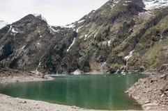 Mountain lake Le Lauvitel stock photo